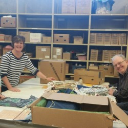 Small group assembling school kits at MCC office, 50 Kent St. Kitchener, ON